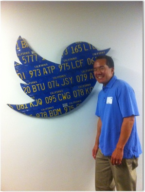 "Dennis Shiao in front of the ""bird"" at Twitter HQ"